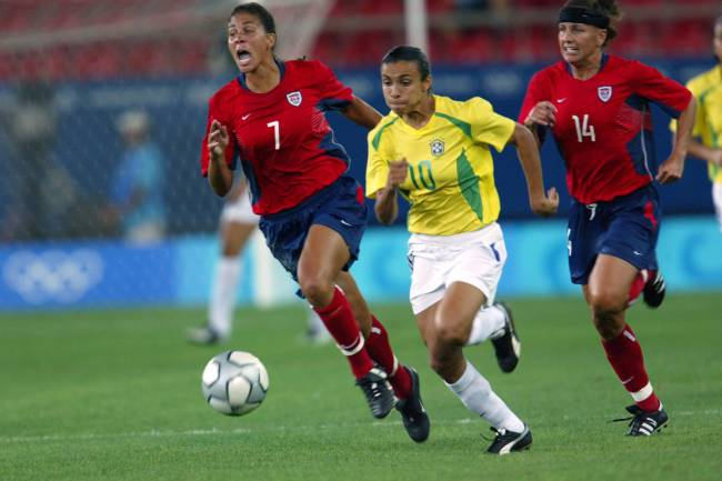 Marta and Shannon Boxx share: It was the Queen's first Olympics