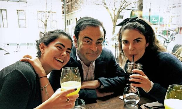 Carlos Ghosn with his daughters Nadine, left, and Caroline.  The executive was born in Brazil and holds French and Lebanese citizenship. Photo: Personal archive
