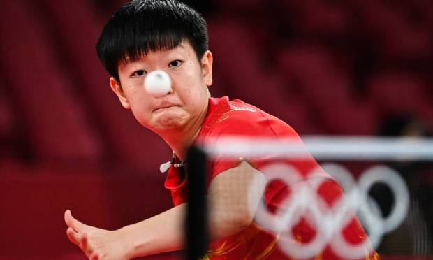 Sun Yingsha of China in a table tennis game against Xiaoxin Yang from Monaco during a table tennis match in the third round of women's singles Photo: Jang Yeon-jae / AFP