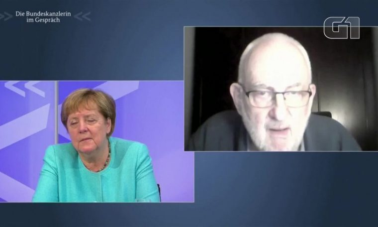 Angela Merkel almost makes noise while talking to citizens about COVID in online meeting.  world