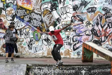 Young skaters juggle at Baxada Fluminense, Latin America's first skate park, Nova Iguaçu