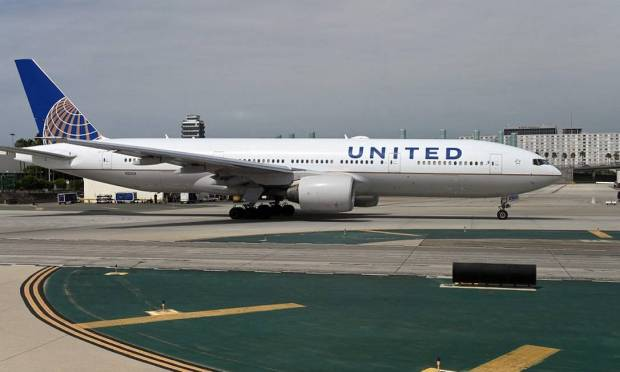 United Airlines is the first major airline to require vaccination of all its employees on the ground and both pilots and flight attendants Photo: Danielle Slim / AFP