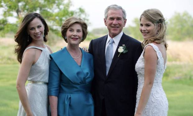 The second generation of the Bush family to occupy the White House.  George W Bush and Laura Bush pose with daughters Barbara and Jenna during the wedding of Jenna and Henry Hager in May 2008. Photo: Archive/White House