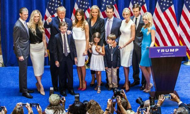 From left, Eric Trump, Lara Yunaska, Donald Trump, Barron, Melania, Vanessa Hayden, Kai Madison, Donald Trump Jr., Donald John Trump III, Ivanka Trump, Jared Kushner and Tiffany Trump pose on stage after their candidacy is announced Huh.  Photo of the presidency in New York in June 2015: Christopher Gregory / Getty Images