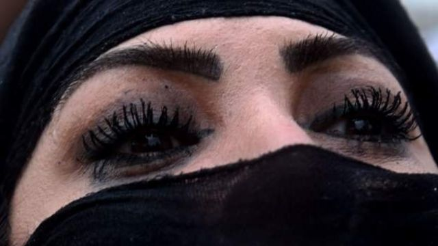 woman with colored eyes and burqa