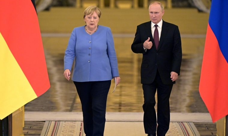 On her last visit to Russia as leader of Germany, Angela Merkel defends talks with Vladimir Putin.  World