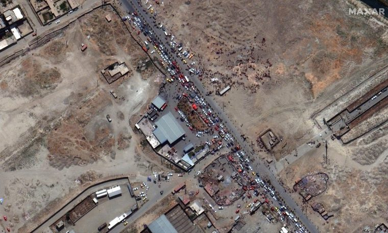 Satellite photos show long lines at the entrance to Kabul airport.  World