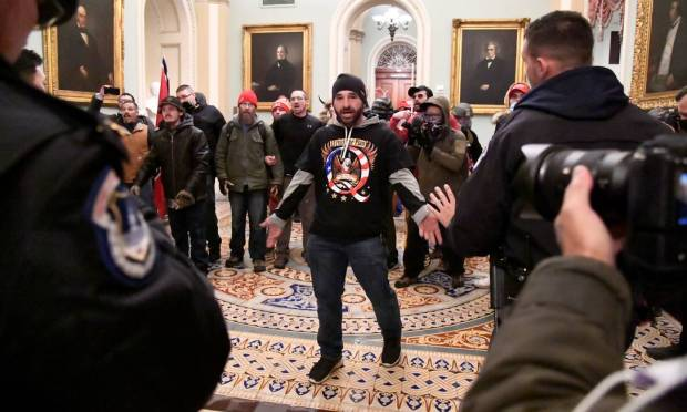 Iowa resident Doug Jensen, 41, was arrested by the FBI early Saturday.  Doug was recognized in the imagery that became iconic during the Capitol riot.  He is the same man, wearing a knit cap and a QAnon T-shirt with an eagle, is seen facing the security of the Congress with open arms.  Photo: MIKE THEILER / REUTERS