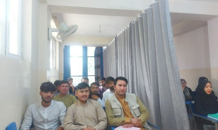 In Afghanistan, the back to school has a room separating men and women with curtains.  World