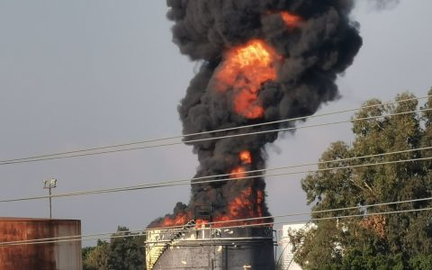 Firefighters dousing a fire in a fuel tank in southern Lebanon.  World