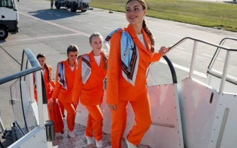 The flight attendant's uniform at the Ukrainian company consists of sneakers and trousers.  from them